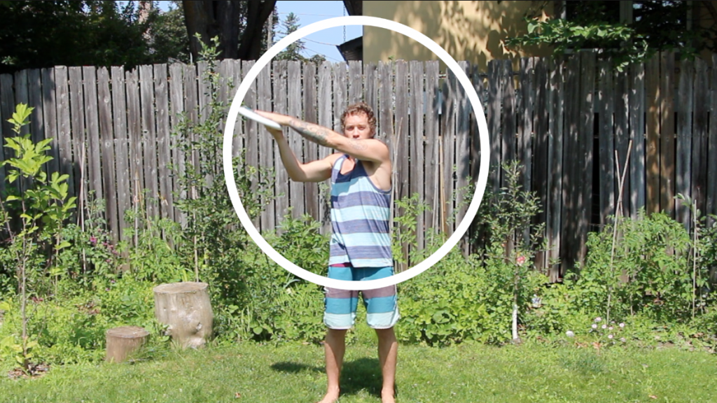 beginner ultimate frisbee players catching with two hands have a smaller target zone